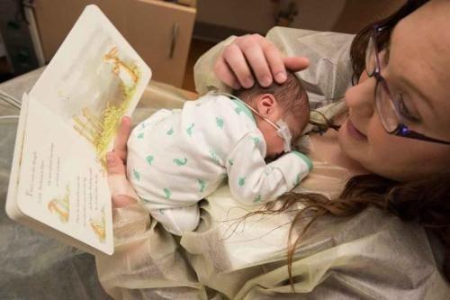 mum reading to baby in nicu